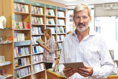 Portrait Of Male Booshop Owner Using Digital Tablet royalty free stock image
