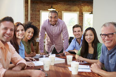 Portrait Of Male Boss With Team In Meeting Stock Photos