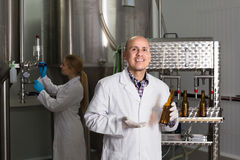 Portrait of male brewery worker. On beer production factory Stock Photography