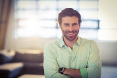 Portrait of male business executive smiling with arms crossed Stock Image