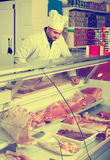 Portrait of male butcher in kosher section at supermarket. Portrait of smiling european  male butcher in kosher section at supermarket Royalty Free Stock Image