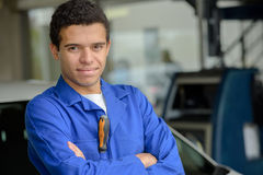 Portrait male car mechanic standing in workshop Stock Image