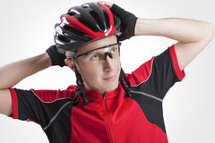 Portrait of Male Caucasian Cyclist Posing in Red Road Protective Helmet and Glasses. Against White Background. Horizontal Shot Stock Photos