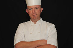 Portrait of a male chef. A male chef posing for a portrait while in uniform Royalty Free Stock Photography