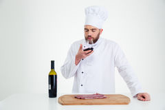 Portrait of a male chef cook degusting wine Royalty Free Stock Photos