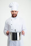 Portrait of a male chef cook holding pan Royalty Free Stock Images