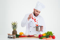 Portrait of a male chef cook preparing sou Royalty Free Stock Photography