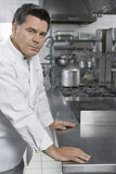 Portrait Of Male Chef In Kitchen Stock Photo