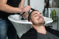 Portrait Of Male Client Getting His Hair Washed Royalty Free Stock Photography