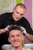 Portrait of male client getting his hair washed at salon Royalty Free Stock Photo