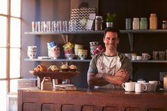 Portrait Of Male Coffee Shop Owner Standing Behind Counter Stock Photos