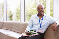Portrait Of Male College Tutor With Digital Tablet Stock Image