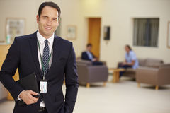 Portrait Of Male Consultant In Hospital Reception Stock Photo