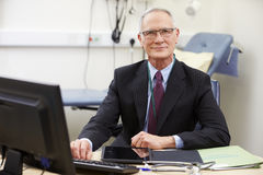 Portrait Of Male Consultant Working At Desk Stock Image