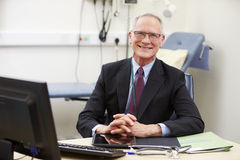 Portrait Of Male Consultant Working At Desk Stock Images