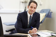 Portrait Of Male Consultant Working At Desk In Office Royalty Free Stock Images