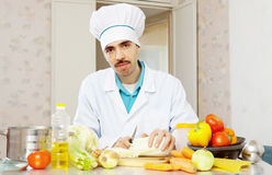 Portrait of male cook with lettuce Stock Images