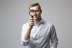 Portrait Of Male Criminologist With Magnifying Glass Stock Image