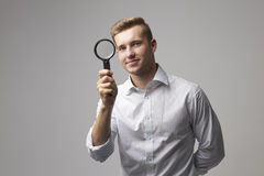 Portrait Of Male Criminologist With Magnifying Glass Royalty Free Stock Photo