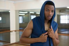 Portrait of male dancer in hooded shirt Royalty Free Stock Images