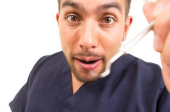 Portrait of male dentist ready to examine looking Royalty Free Stock Photo