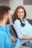 Portrait of a male dentist and young happy  female patient. Stock Photography