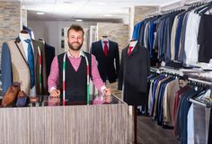 Portrait of male designer which is standing on workplace. In man shop stock photo