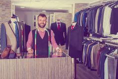 Portrait of male designer which is standing on workplace. In man shop royalty free stock images