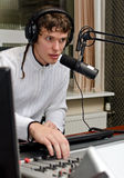 Portrait of male dj working Royalty Free Stock Photography