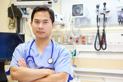 Portrait Of Male Doctor In Emergency Room. Looking To Camera With Arms Crossed royalty free stock images