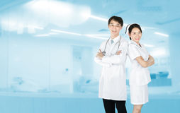 Portrait of male doctor and female nurse in uniform standing and Royalty Free Stock Images