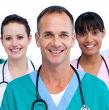 Portrait of a male doctor and his medical team. Against a white background Royalty Free Stock Photography