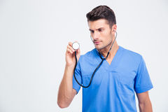Portrait of a male doctor holding stethoscope. Isolated on a white background Royalty Free Stock Images