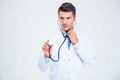 Portrait of a male doctor holding stethoscope Royalty Free Stock Photos
