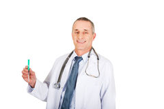 Portrait of male doctor holding a syringe Royalty Free Stock Photo