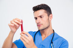 Portrait of a male doctor holding test tube Royalty Free Stock Photos