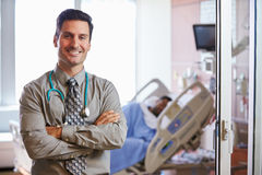 Portrait Of Male Doctor With Patient In Background Royalty Free Stock Photos