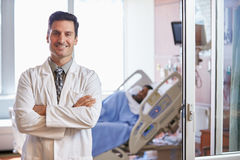 Portrait Of Male Doctor With Patient In Background Stock Image