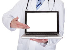 Portrait of male doctor showing laptop Royalty Free Stock Images