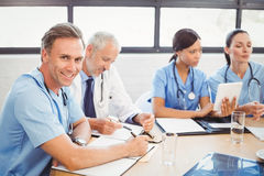 Portrait of male doctor smiling in conference room Stock Photo