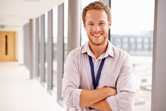 Portrait Of Male Doctor Standing In Hospital Corridor Stock Photography