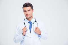 Portrait of a male doctor standing with stethoscope. Isolated on a white background Stock Photos
