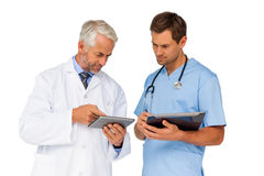 Portrait of male doctor and surgeon with digital tablets Royalty Free Stock Images