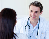 Portrait of a male doctor talking with his patient Royalty Free Stock Photo