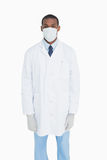 Portrait of male doctor wearing mask and gloves Royalty Free Stock Images