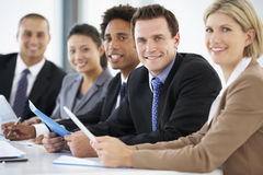 Portrait Of Male Executive Attending Office Meeting With Colleagues Stock Photography