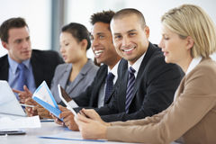 Portrait Of Male Executive Attending Office Meeting With Colleagues Royalty Free Stock Photos