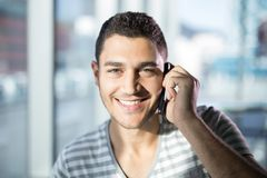 Portrait of male executive talking on mobile phone Stock Photo