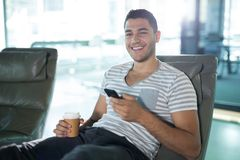 Portrait of male executive using mobile phone. In futuristic office Stock Image