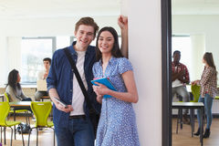 Portrait Of Male And Female College Students In Classroom Stock Photos